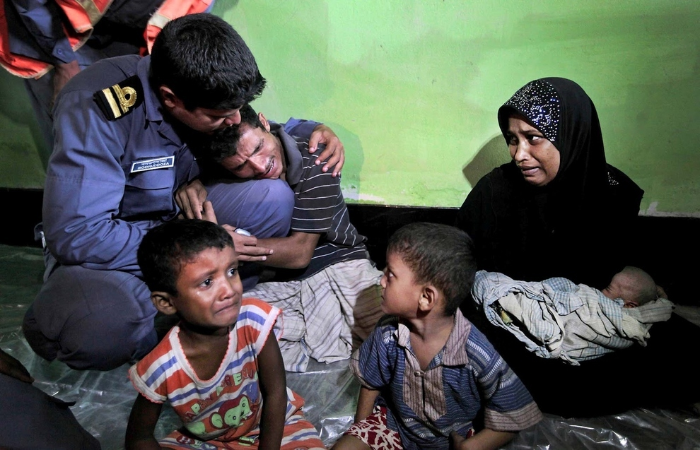 Rohingya refugee family beg the Bangladeshi coast guard to not deport them